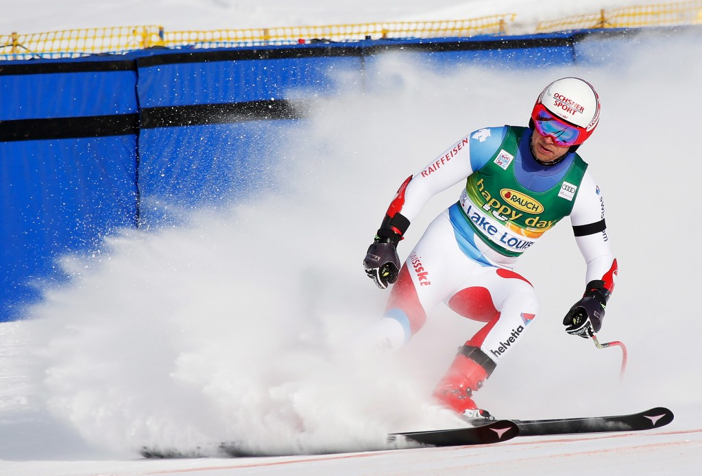Mauro Caviezel, of Switzerland, reacts in the finish area at the men's World Cup super-G ski race at Lake Louise, Alberta, Sunday, Nov. 25, 2018. (Jef...