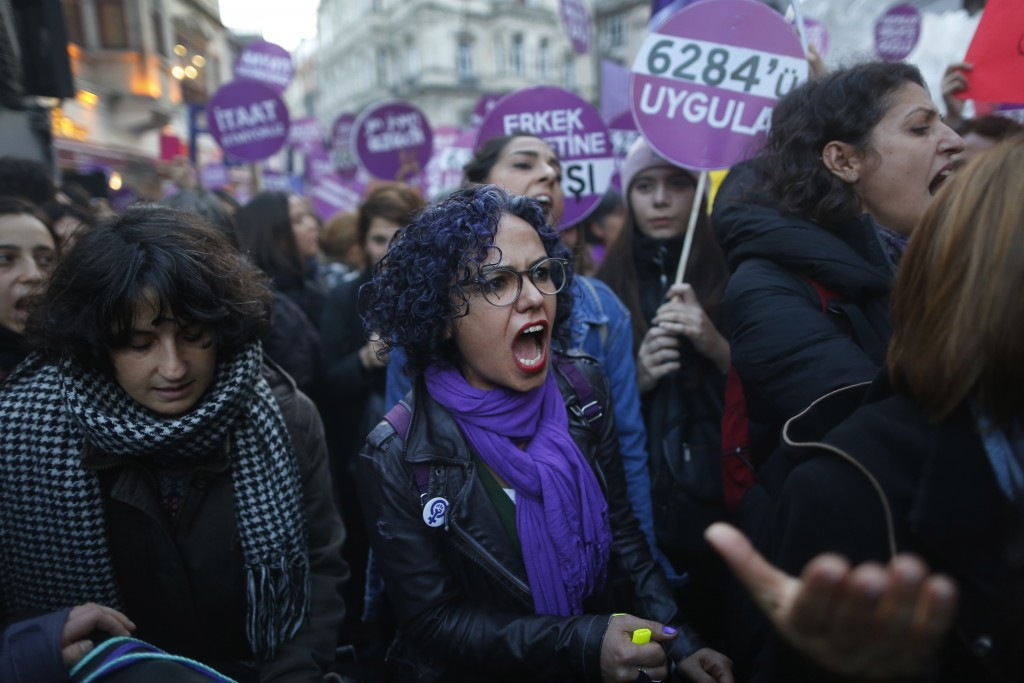 Protesters, mostly women, display placards and chant slogans during a rally in central Istanbul, Sunday, Nov. 25, 2018, to mark the United Nations' In
