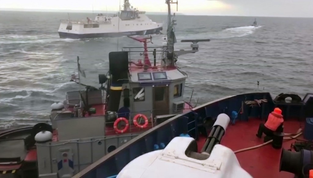 In this image taken from video released by the Russia's Federal Security Service taken from a Russian Coast Guard vessel purporting to show an inciden...