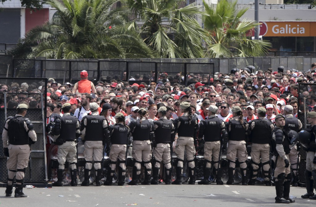 Security forces stand guard outside outside Antonio Vespucio Liberti stadium where River Plate soccer fans  gather before the announcement that their ...