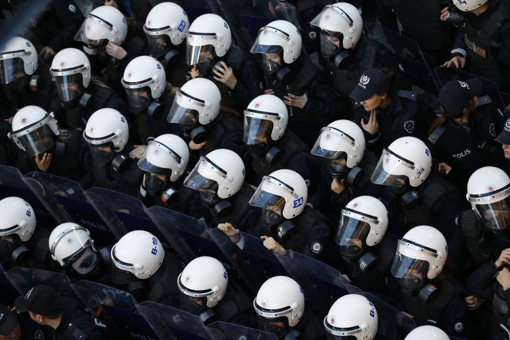 A phalanx of Turkish police officers in riot gear, block protesters during a rally in central Istanbul's Istiklal Avenue, the main shopping road of Is...