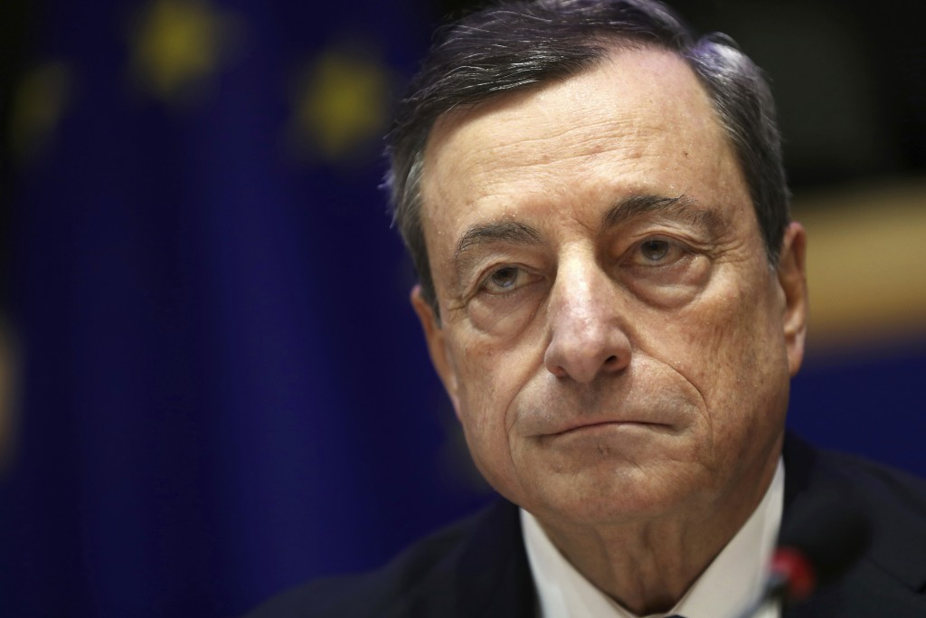 European Central Bank President Mario Draghi listens to a speech during an Economic and Monetary Affairs meeting at the European Parliament in Brussel...