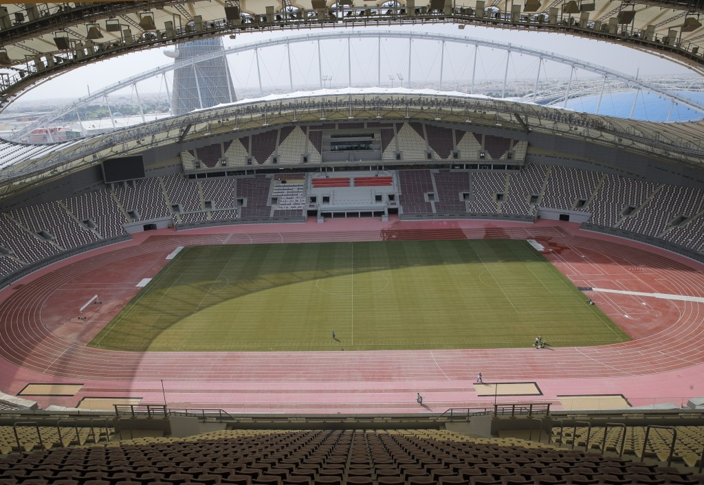 In this Wednesday, Oct. 31, 2018 picture men perform modernization work on the Khalifa International Stadium in Doha, Qatar. Eight stadiums scattered ...