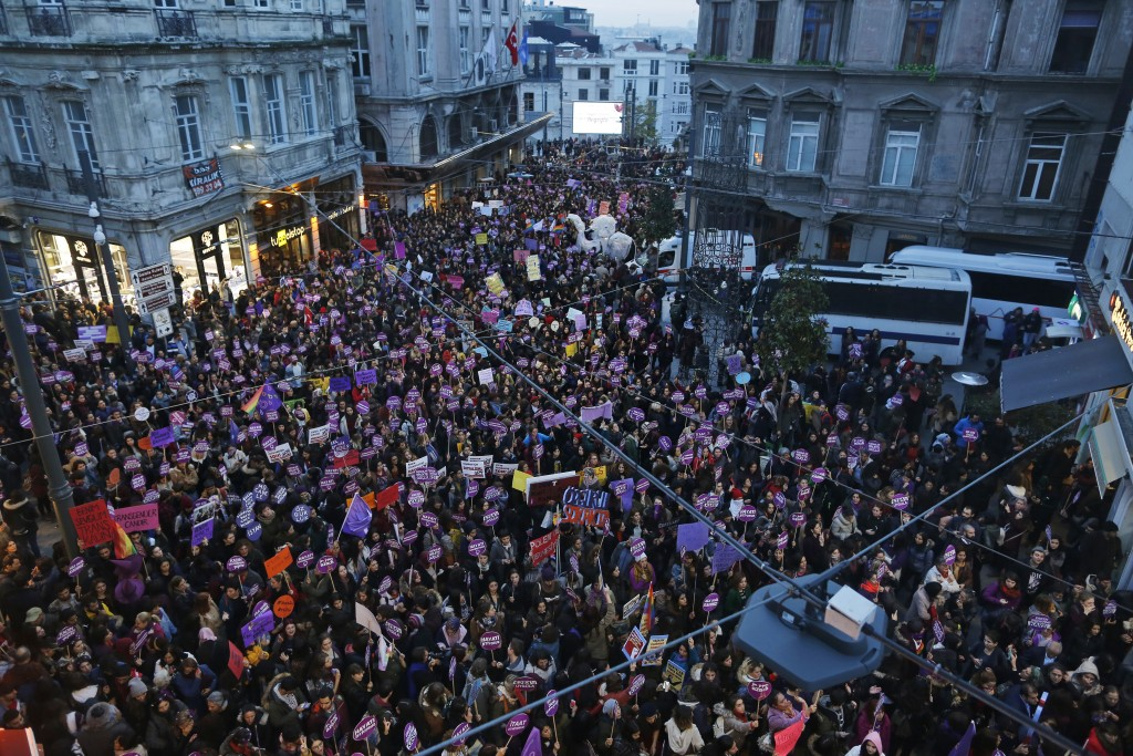 Protesters, display placards and chant slogans during a rally in central Istanbul, Sunday, Nov. 25, 2018, to mark the United Nations' International Da...