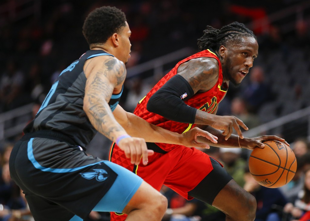 Atlanta Hawks forward Taurean Prince (12) drives to the basket as Charlotte Hornets forward Miles Bridges (0) defends in the first half of an NBA bask...