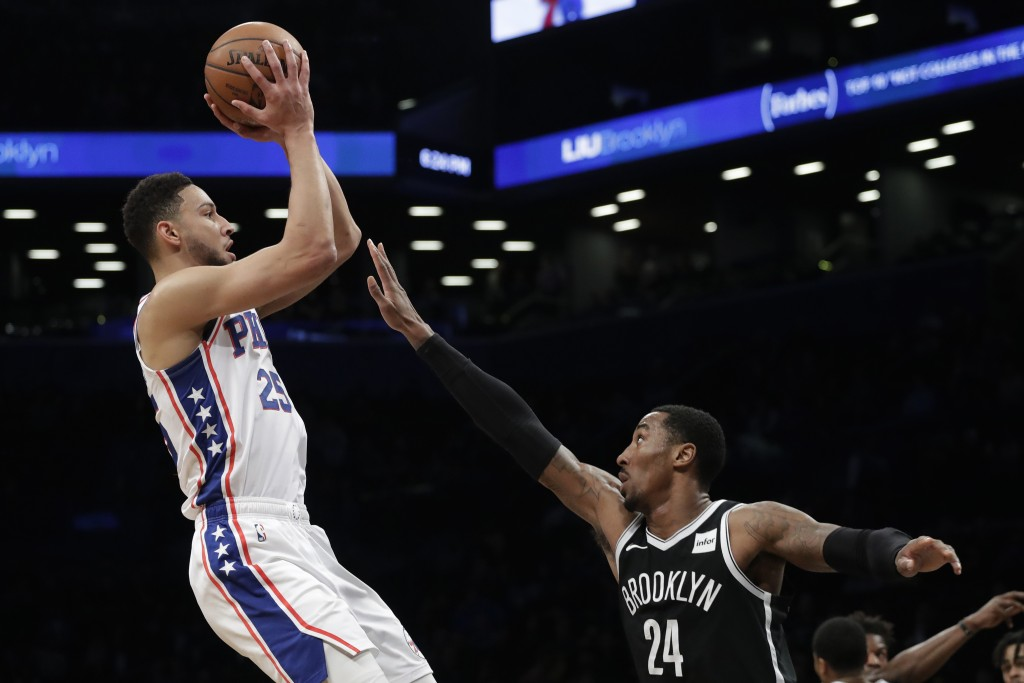 Philadelphia 76ers' Ben Simmons (25) shoots over Brooklyn Nets' Rondae Hollis-Jefferson (24) in the first quarter of an NBA basketball game, Sunday, N