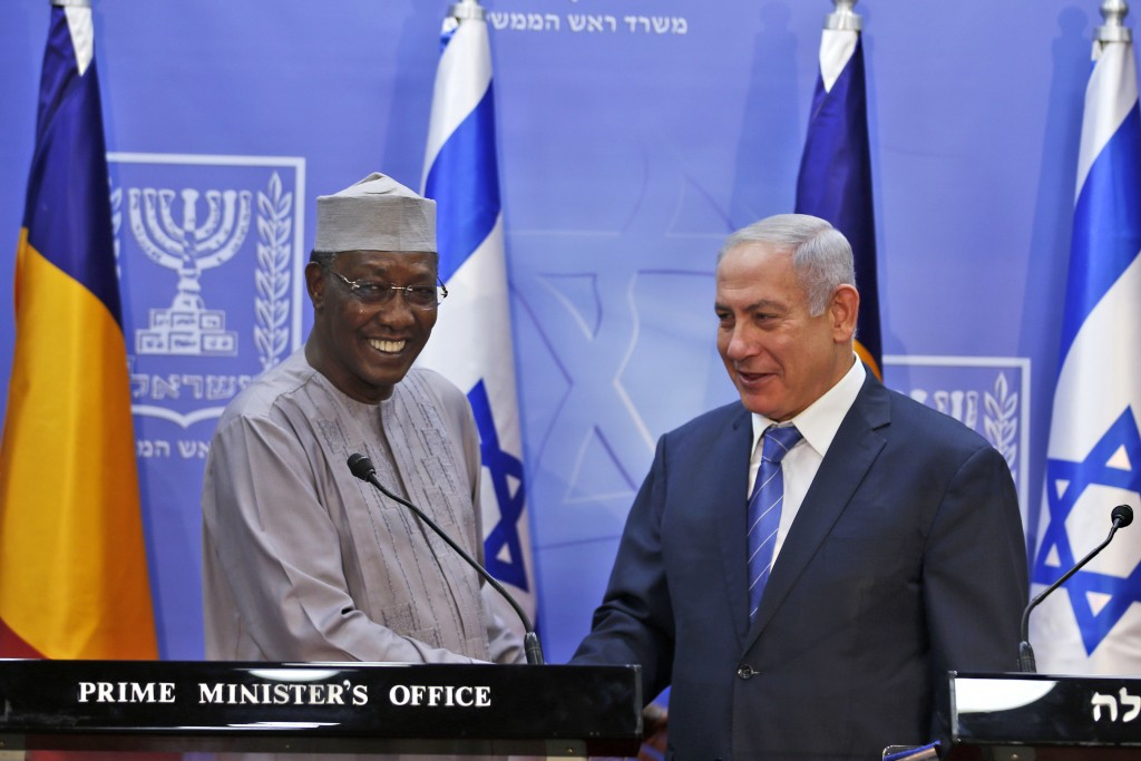 Israeli Prime Minister Benjamin Netanyahu, right, and President of Chad Idriss Deby give a joint press conference, in Jerusalem, Sunday, Nov. 25, 2018...