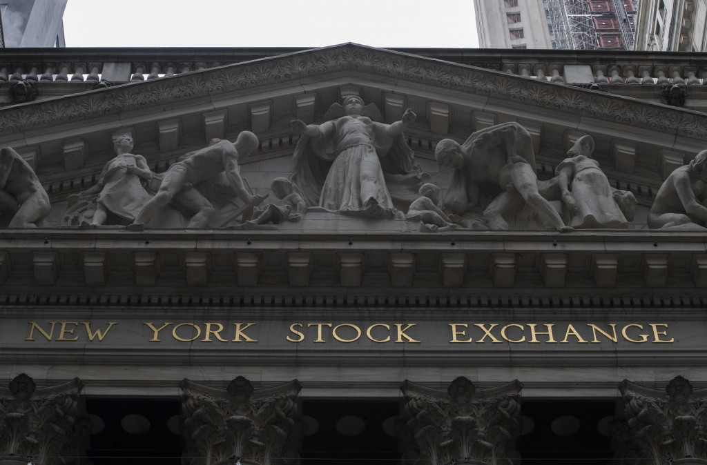 FILE- This Nov. 20, 2018, file photo shows the facade of the New York Stock Exchange. The U.S. stock market opens at 9:30 a.m. EST on Monday, Nov. 26.