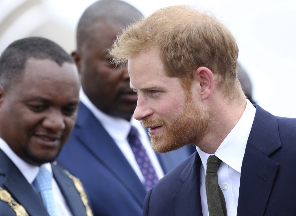 Britain's Prince Harry is welcomed upon his arrival at Kenneth Kaunda airport in Lusaka, Zambia, Monday, Nov. 26, 2018. Prince Harry is on a State vis