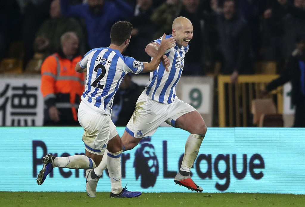 Huddersfield Town's Aaron Mooy, right, celebrates scoring his side's second goal of the game against Wolverhampton, with team-mate Tommy Smith, during