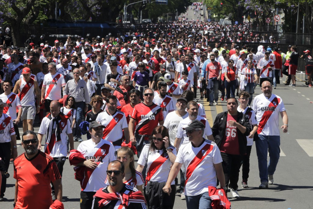 River Plate soccer fans leave Antonio Vespucio Liberti stadium after the final Copa Libertadores soccer match against arch-rival Boca Juniors was susp...