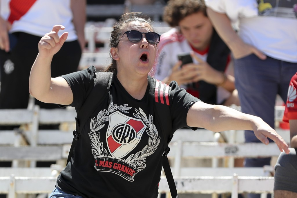A fan of Argentina's River Plate reacts to the announcement that the final Copa Libertadores match against Argentina's Boca Juniors was suspended, at ...