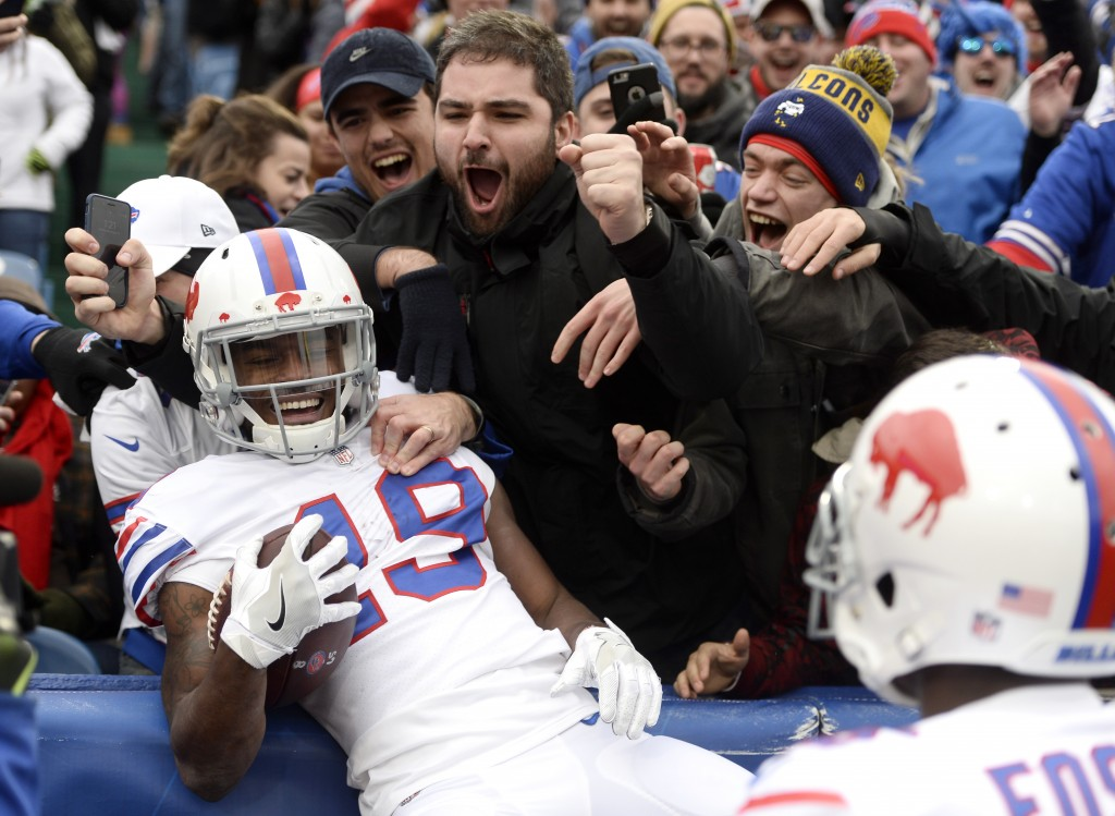 Buffalo Bills wide receiver Isaiah McKenzie (19) celebrates his touchdown run with fans during the first half of an NFL football game against the Jack