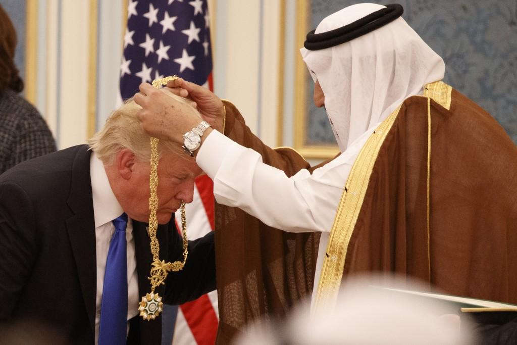 FILE -- In this May 20, 2017 file photo, Saudi King Salman presents President Donald Trump with the highest civilian honor, the Collar of Abdulaziz Al