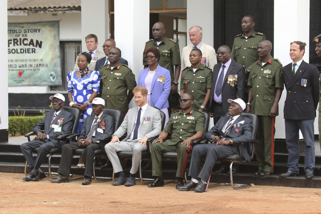 Britain's Prince Harry poses for a photo with war Veterans and widows during his visit at the Burma Barracks in Lusaka, Tuesday, November 27, 2018. Ha...