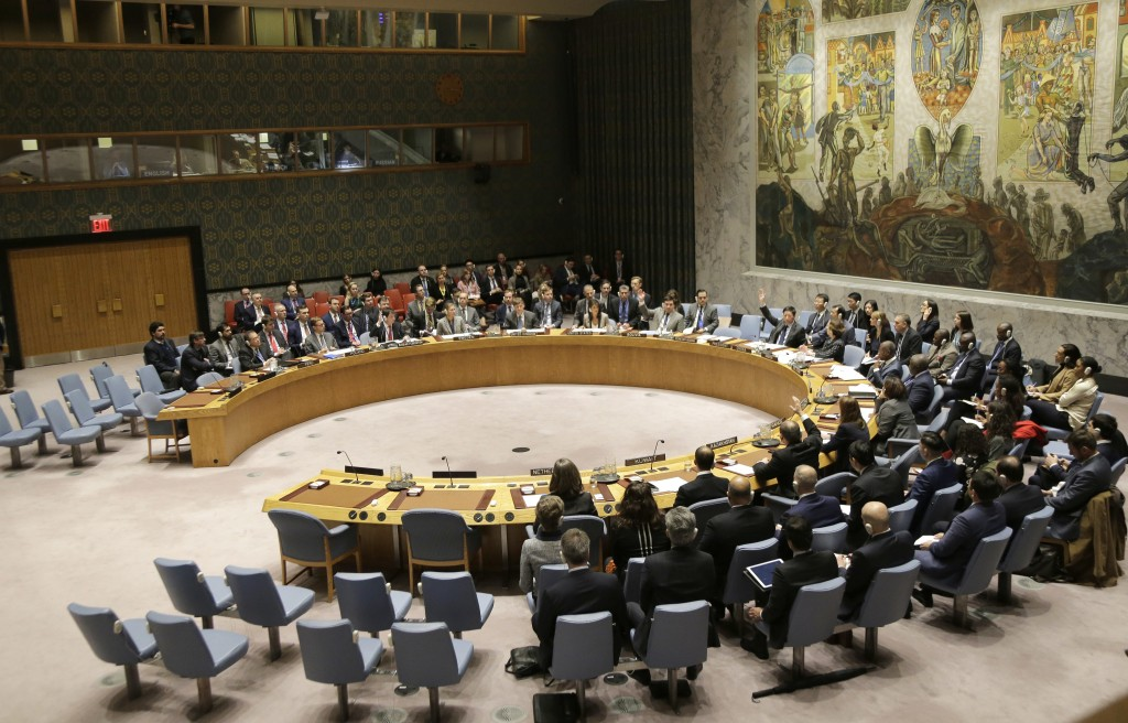 Members of the Security Council vote during a meeting about the escalating tensions between the Ukraine and Russia at United Nations headquarters, Mon...