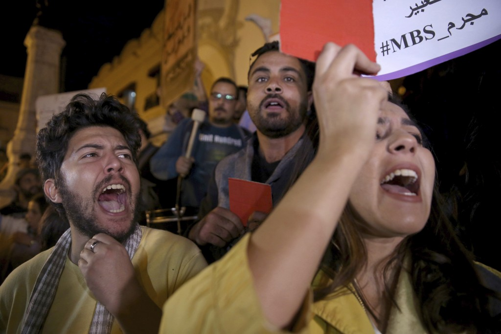 Activists stage a protest in downtown Tunis, Tunisia, on the eve of Saudi Crown Prince Mohammed bin Salman's official visit to Tunisia, to denounce th...