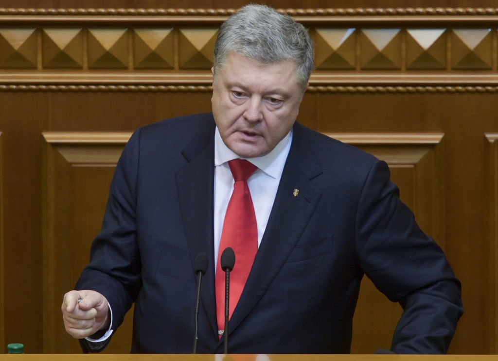 Ukrainian President Petro Poroshenko gestures during a parliament session in Kiev, Ukraine, Monday, Nov. 26, 2018. Ukraine's president on Monday urged