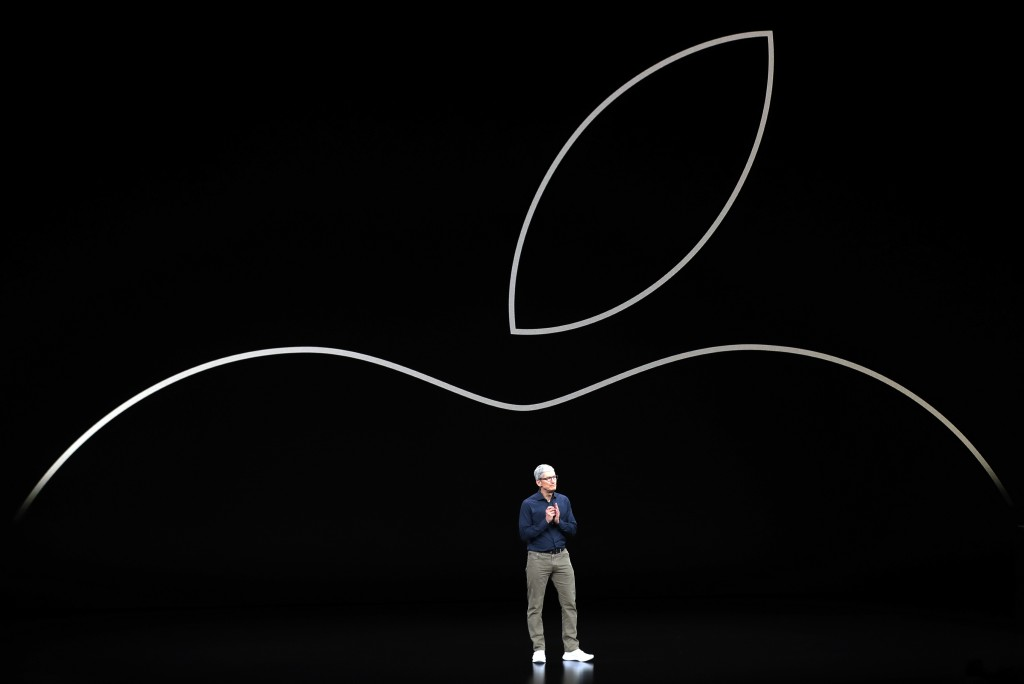 FILE- In this Sept. 12, 2018, file photo Apple CEO Tim Cook discusses the new Apple iPhones and other products at the Steve Jobs Theater during an eve