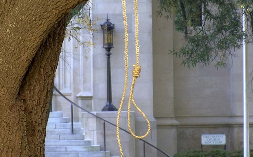 In this photo provided by WLBT-TV a noose hangs on a tree on the state capitol grounds in Jackson, Miss. on Monday, Nov. 26, 2018. A Mississippi offic