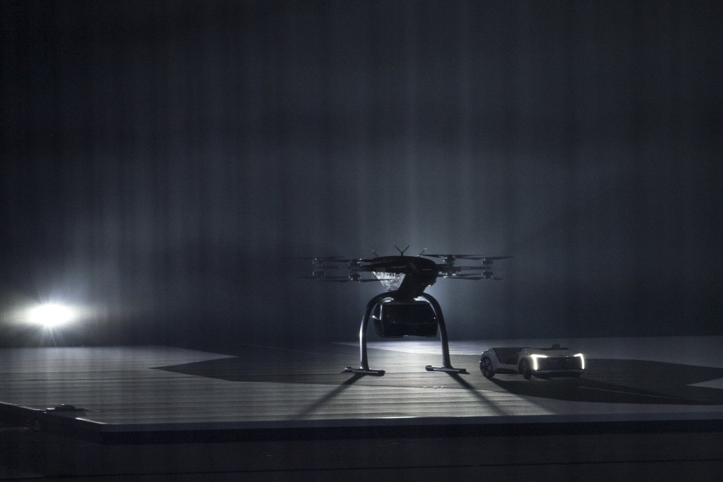The ground module of a working scale model of Pop.Up Next, a prototype designed by Audi, Airbus and Italdesign, drives away from the air module, cente