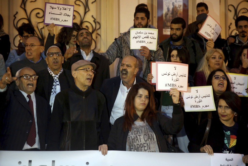 """Activists hold up placards that read """"No to repression of freedom of expression #MBS assassin"""" on the eve of Saudi Crown Prince Mohammed bin Salman's"""