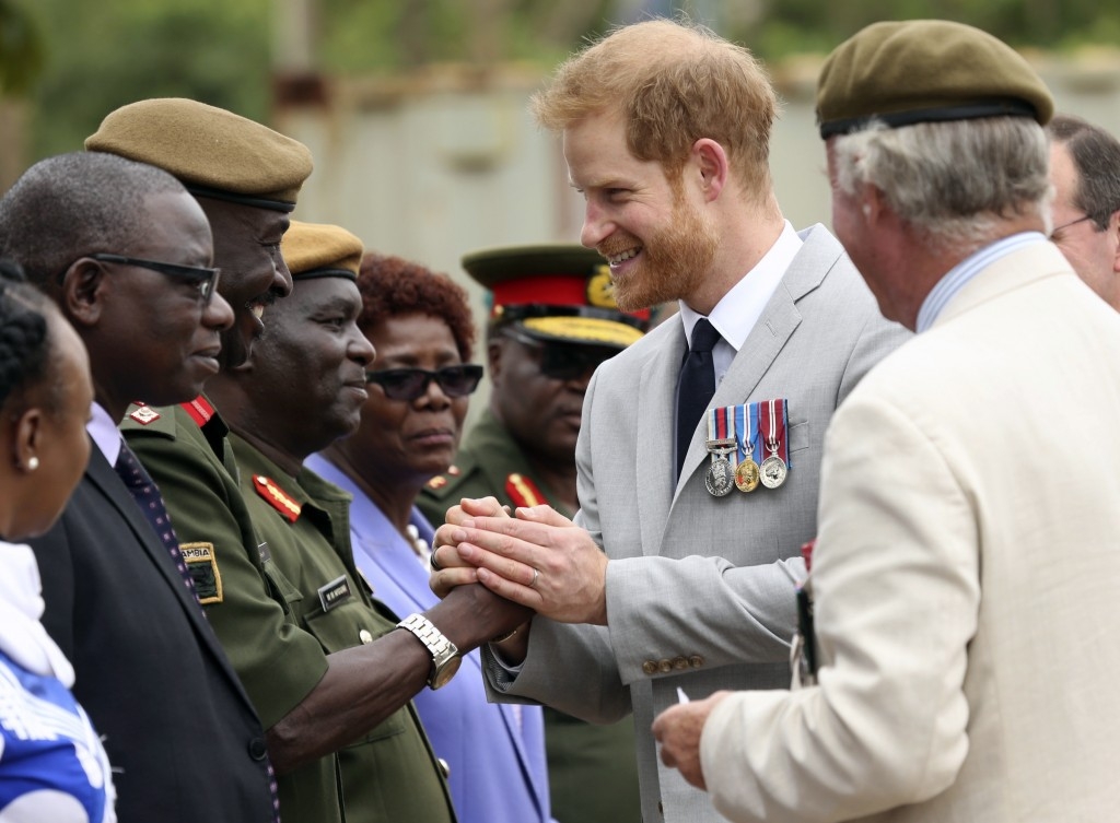 Britain's Prince Harry arrives at the Burma Barracks for a meeting with war veterans and widows in Lusaka, Tuesday, November 27, 2018. Prince Harry is