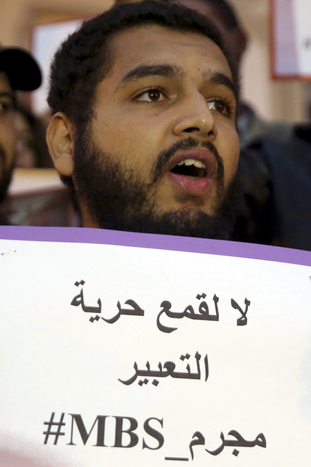 "An activist holds up a placard that reads ""No to repression of freedom of expression #MBS assassin"" on the eve of Saudi Crown Prince Mohammed bin Salm..."