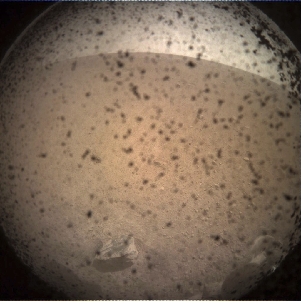 This photo provided by NASA shows the first image acquired by the InSight Mars lander after it touched down on the surface of Mars Monday, Nov. 26, 20