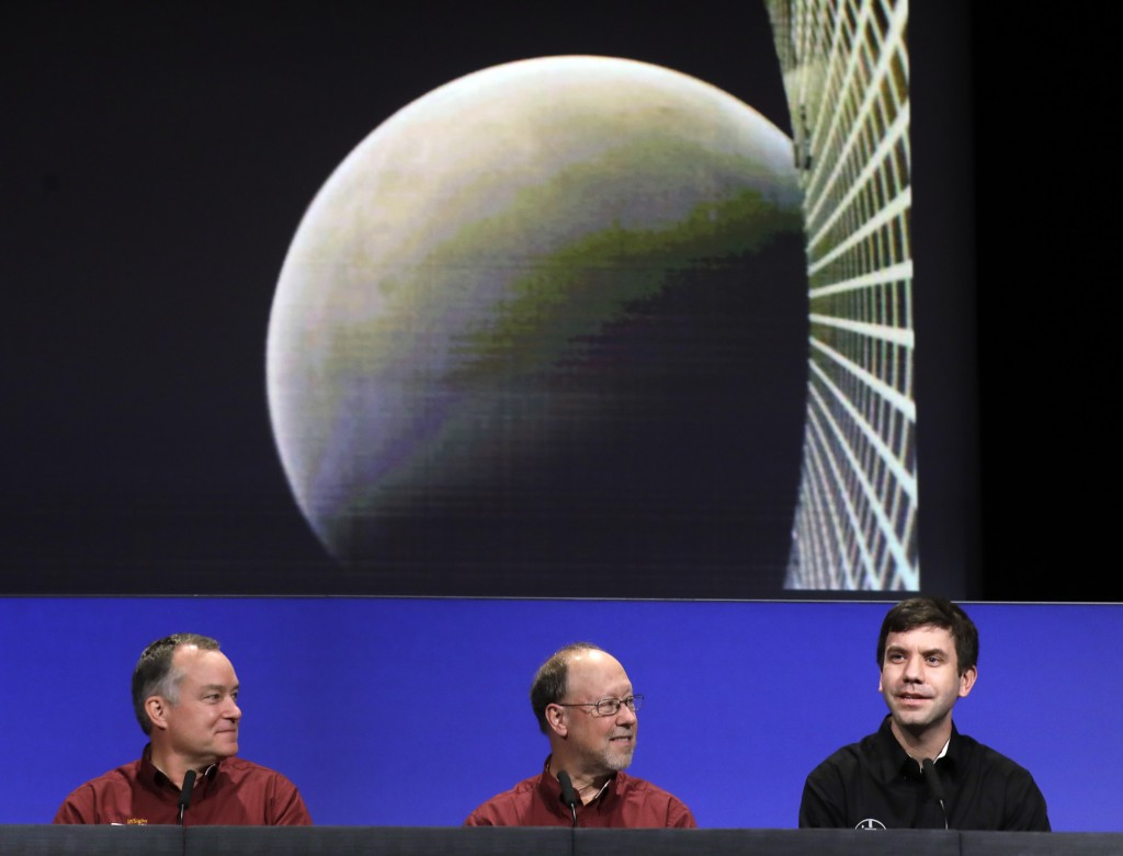 CORRECTS TO SAY THE PHOTO WAS TAKEN BY A MINI SATELLITE, NOT THE LANDER - NASA official Andrew Klesh, right, speaks next to his colleagues, project ma...