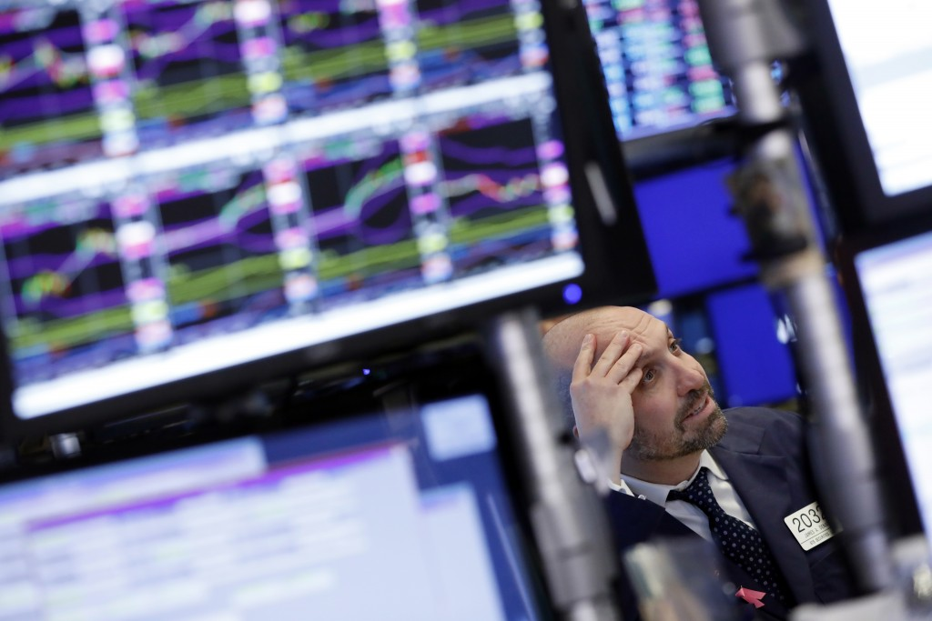 Specialist James Denaro works at his post on the floor of the New York Stock Exchange, Monday, Nov. 26, 2018. Global markets are rising Monday as big