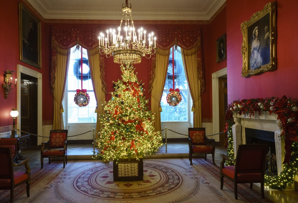 The Red Room, with the theme to celebrate America's Children, is seen during the 2018 Christmas preview at the White House in Washington, Monday, Nov.