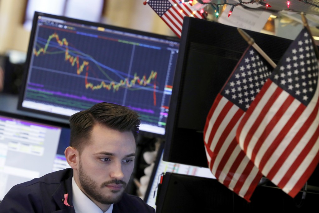 Specialist Matthew Greiner works at a post on the floor of the New York Stock Exchange, Monday, Nov. 26, 2018. Global markets are rising Monday as big...