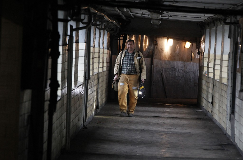 In this Nov. 21, 2018 photo a miner leaves the shaft after an underground shift at the Wujek coal mine in Katowice, in Poland's southern mining region