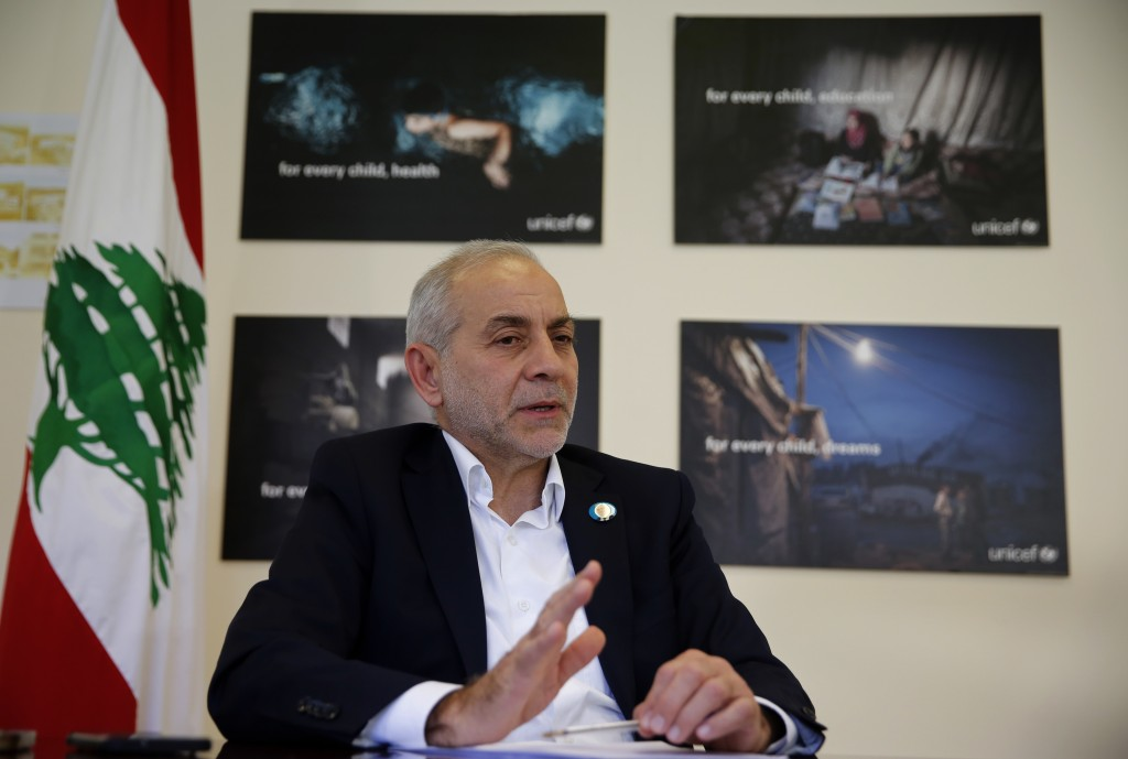 Lebanese Minister of State for Refugee Affairs, Mouin Merhebi, speaks during an interview with the Associated Press, at his office, in Beirut, Lebanon