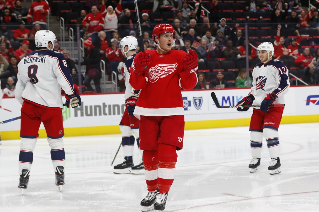 Detroit Red Wings right wing Gustav Nyquist (14) celebrates his goal against the Columbus Blue Jackets in the second period of an NHL hockey game Mond...