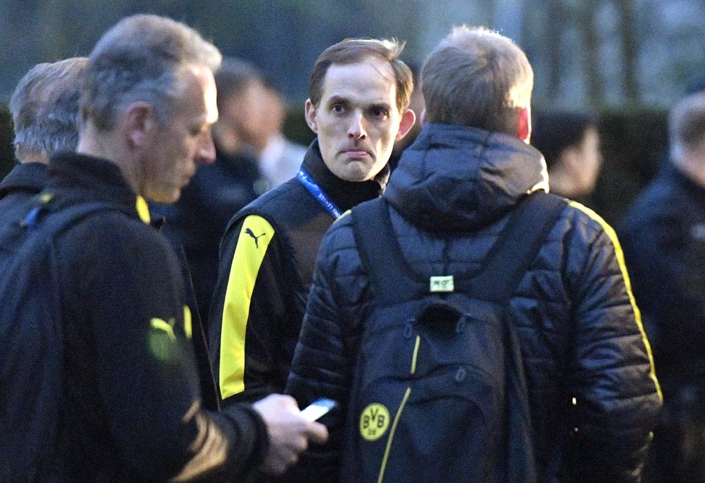 FILE - In this April 11, 2017 file photo then Dortmund head coach Thomas Tuchel stands outside the team bus after it was damaged in an explosion befor