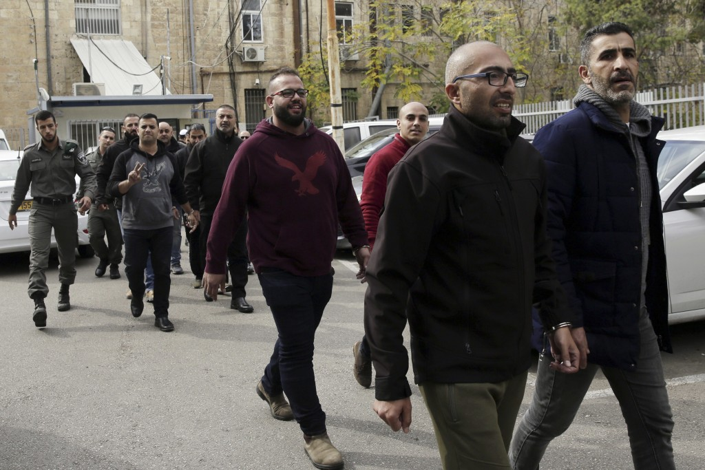 Arrested Palestinians are brought to a court in Jerusalem, Monday, Nov.26, 2018. Israeli police have arrested 32 Palestinians from east Jerusalem, acc