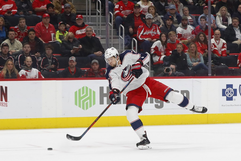 Columbus Blue Jackets right wing Josh Anderson (77) shoots against Detroit Red Wings goaltender Jimmy Howard in the first period of an NHL hockey game...