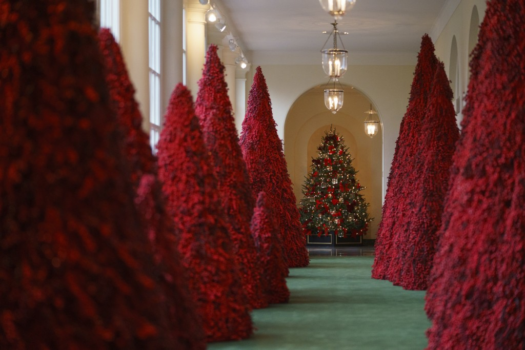 Topiary trees line the East colonnade during the 2018 Christmas Press Preview at the White House in Washington, Monday, Nov. 26, 2018. Christmas has a...