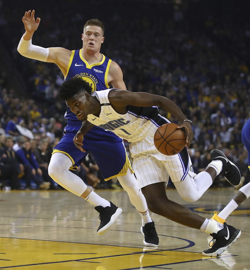 Orlando Magic's Jonathan Isaac (1) drives the ball against Golden State Warriors' Jonas Jerebko during the first half of an NBA basketball game Monday