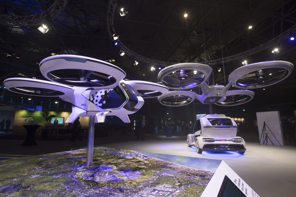 An Airbus passenger drone and Pop.Up Next, rear, a prototype designed by Audi, Airbus and Italdesign is displayed at the Amsterdam Drone Week in Amste