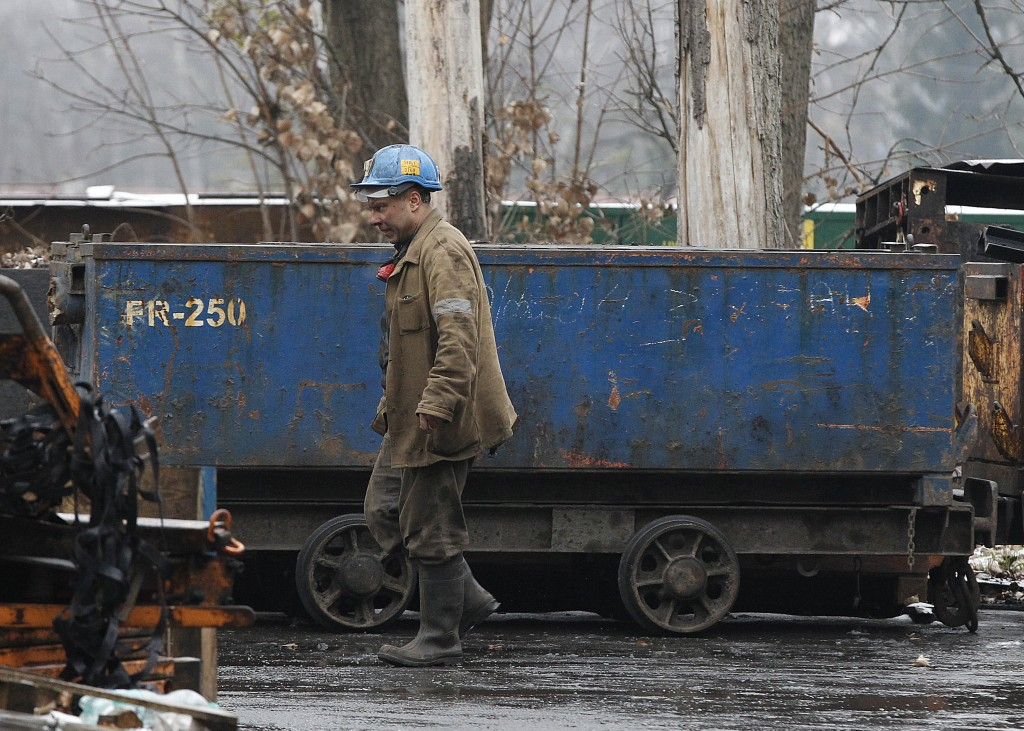 In this Nov. 21, 2018 photo a miner passes by a lorry at at the Wujek coal mine in Katowice, in Poland's southern mining region of Silesia. The mining...