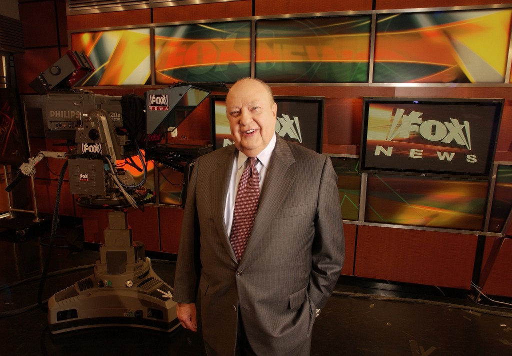"""FILE - In this Sept. 29, 2006 file photo, Fox News CEO Roger Ailes poses at Fox News in New York.  A new documentary, """"Divide and Conquer: The Story o"""