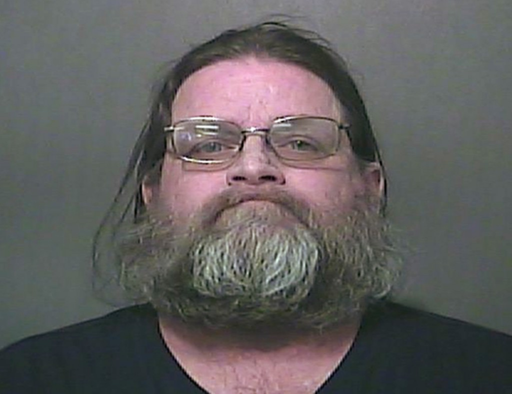 FILE - This file photo provided by the Vigo County Sheriff's Department in Terre Haute, Ind., shows Hubert Kraemer, one of four people charged with ne...