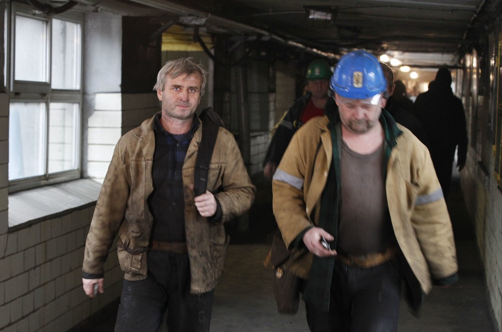 In this Nov. 21, 2018 photo miners leave the shaft after an underground shift at the Wujek coal mine in Katowice, in Poland's southern mining region o...