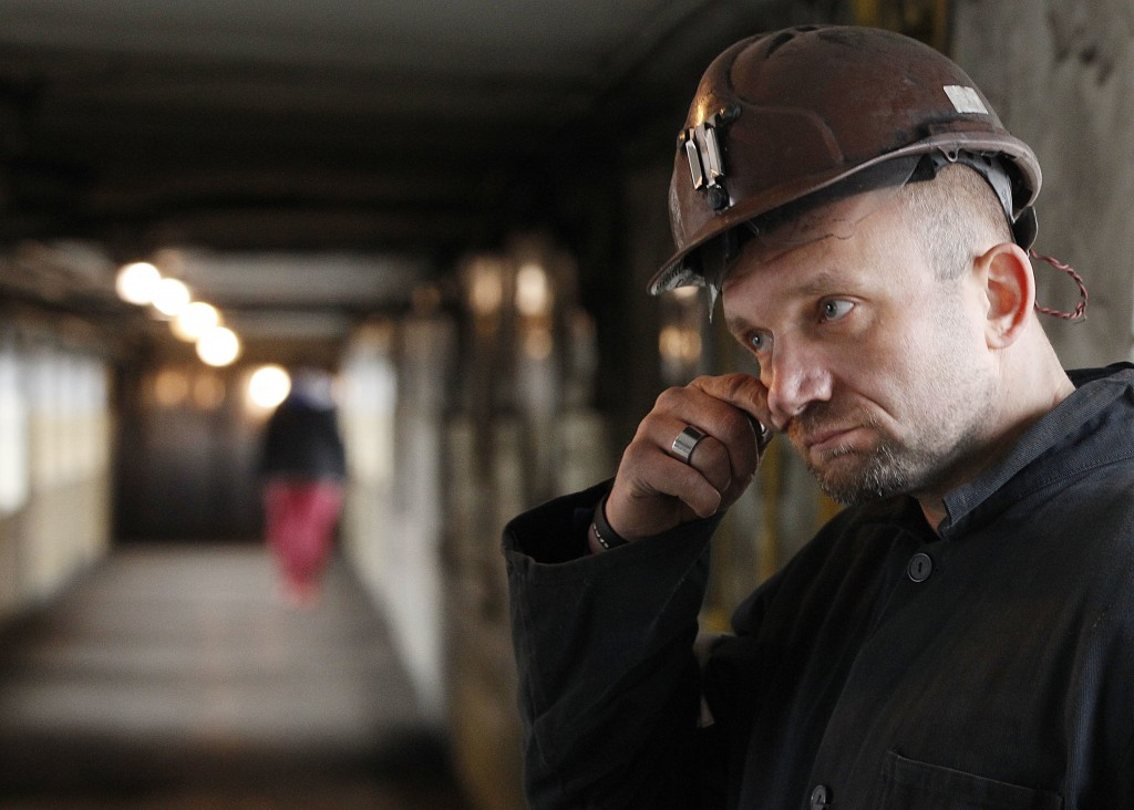 The Nov. 21, 2018 photo shows Tomasz Mlynarczyk, who operates heavy machinery to extract coal at the Wujek coal mine in Katowice, in Poland's southern