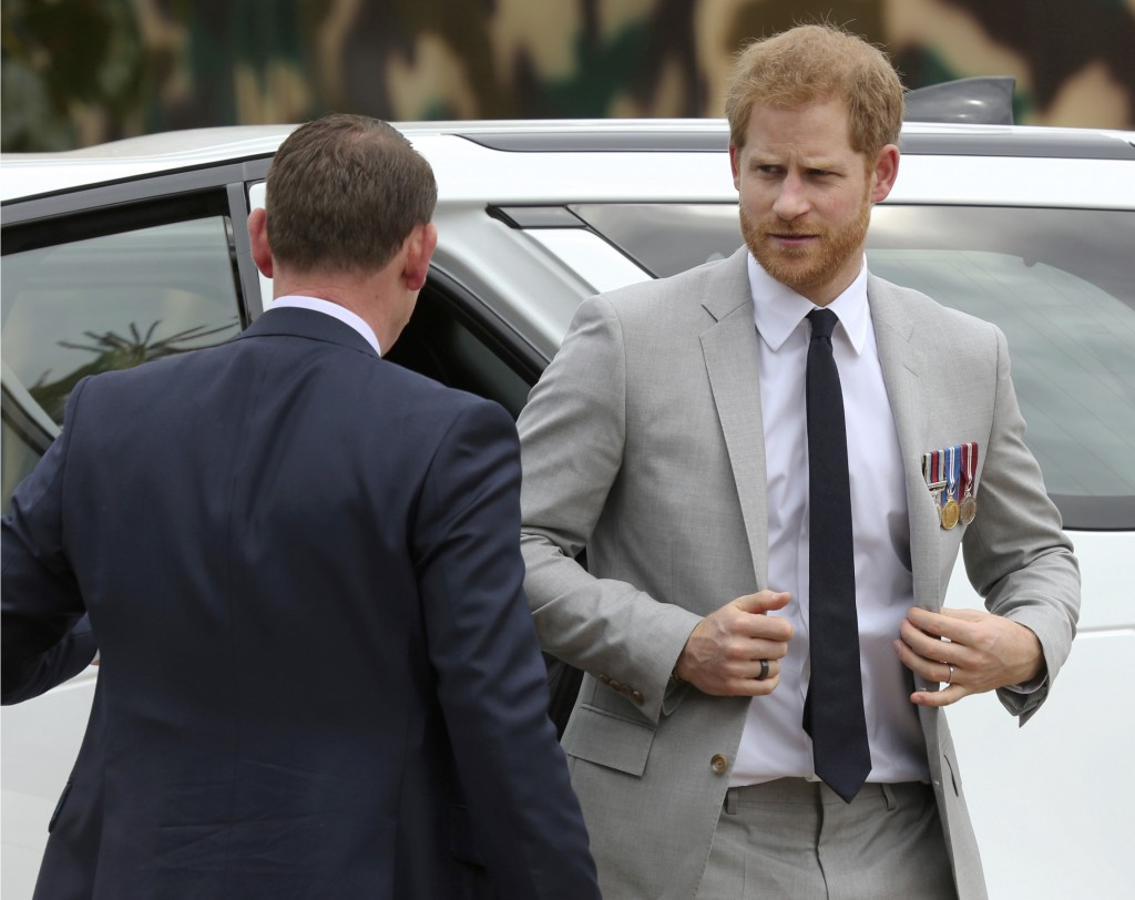 Britain's Prince Harry, right, arrives at the Burma Barracks for a meeting with war veterans and widows in Lusaka, Tuesday, November 27, 2018. Prince