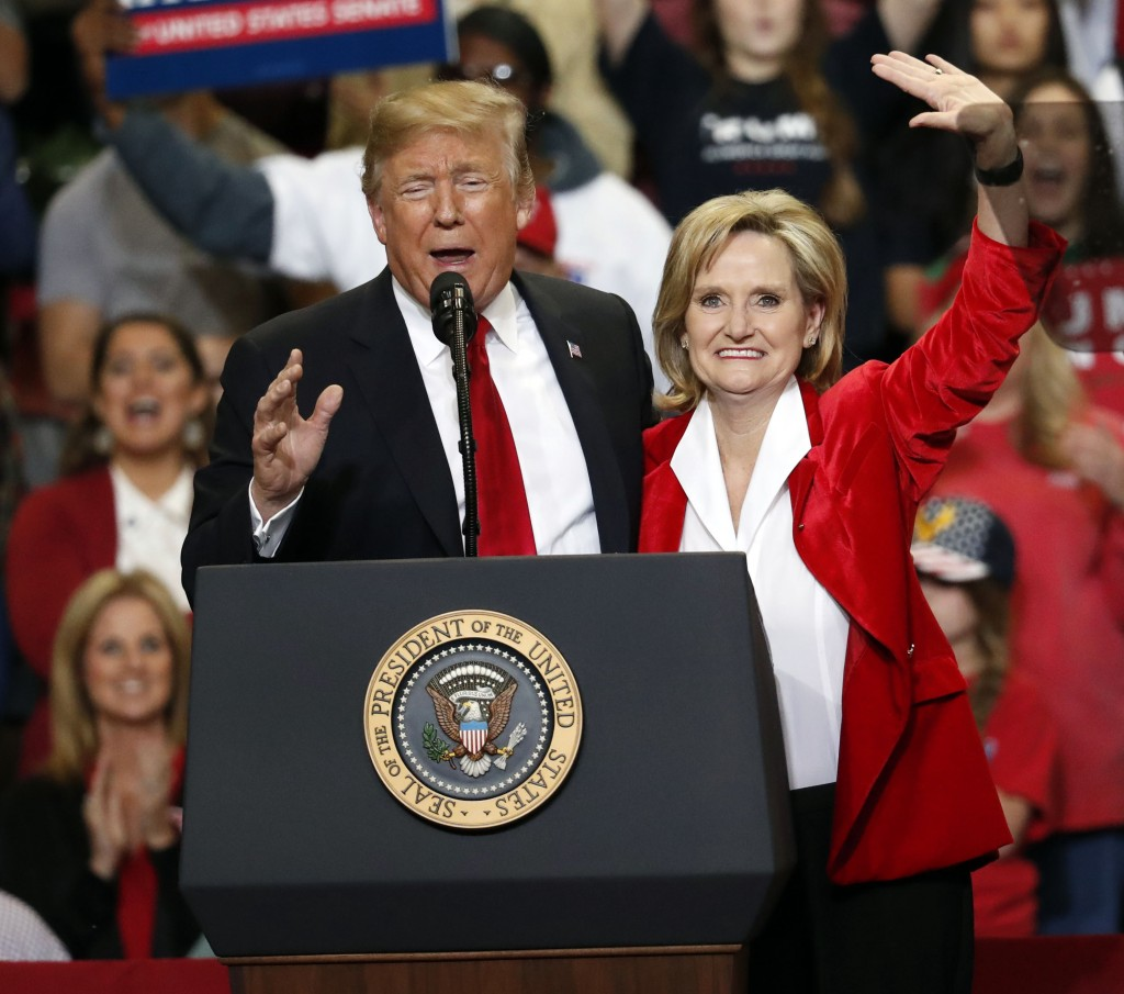 President Donald Trump encourages voters to support appointed Republican U.S. Sen. Cindy Hyde-Smith in a runoff race Tuesday against Democrat Mike Esp...