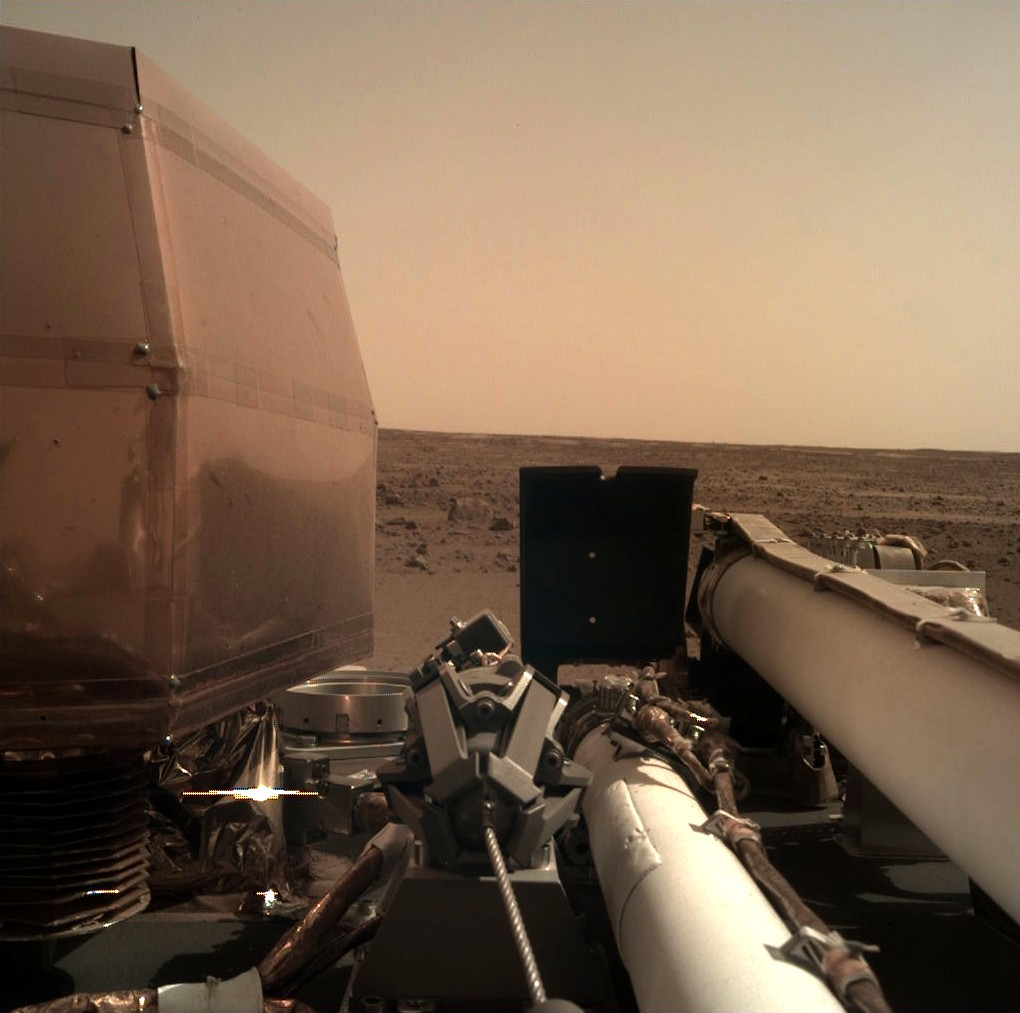 This photo provided by NASA shows an image on Mars that its spacecraft called InSight acquired using its robotic arm-mounted, Instrument Deployment Ca...